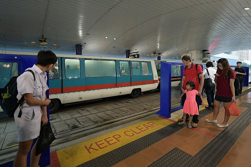 Safety barriers at the Bukit Panjang LRT station. Such barriers have been installed at the platforms of all stations on the Bukit Panjang LRT line, to prevent commuters from falling onto the tracks.