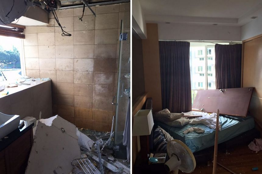 The force of the water heater blast last Saturday blew out the bathroom window (left) and sent the bathroom door flying across the bedroom (right). The condominium unit's tenant, who would give his name only as Mr Eduardo, said he had taken a bath ju