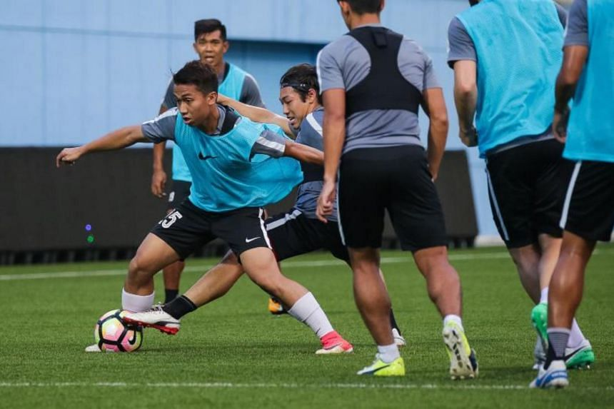 Garena Young Lions' right back Rusyaidi Salime (with ball) at a training session with the national team at the Jalan Besar Stadium on Sept 26,  2017.