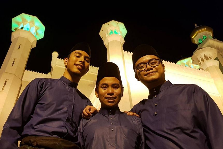 (From left) Muhammad Amruu Hussein Ismail, Muhammad Imran Mohammad Yusoff and Afiq Zikry Zulkiffli will be at the procession dressed like in their school uniforms of blue Malay traditional costumes with songkok and songket sarong.