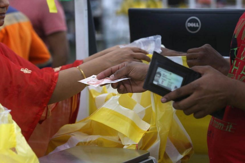 Cash is king because many migrant workers do not have a bank account or an ATM card due to minimum sum requirements imposed by most banks, says Maybank.