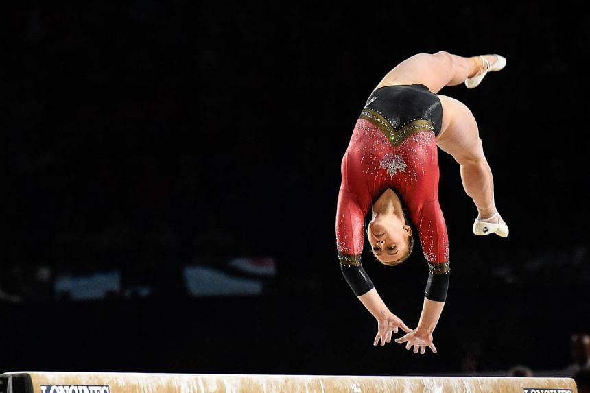 Ellie Black is in the lead with 55.766 points in the all-around final qualifier, with three subdivisions to go.