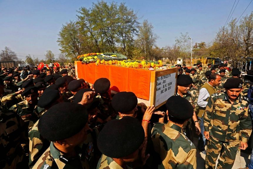 Indian Border Security Force soldiers carry the coffin of their fallen colleague, who was killed in a gunfight with suspected militants at an Indian Border Security Force (BSF) camp on Tuesday.