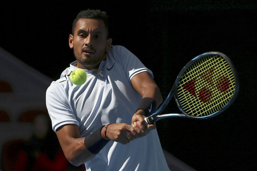 Nick Kyrgios earned a warning from the umpire when he smashed his racquet after losing the first set of the match.