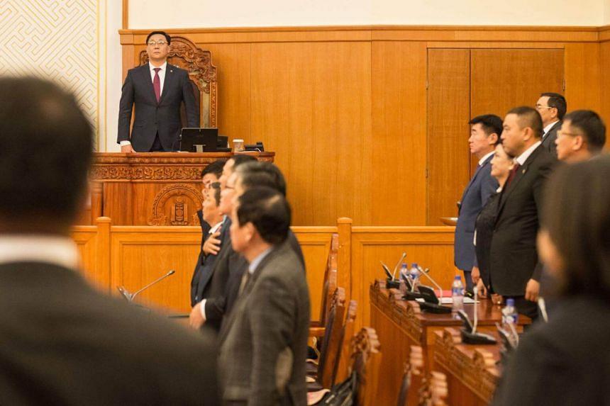Ex-premier Jargaltulgiin Erdenebat (standing in the back) was ousted in early September.