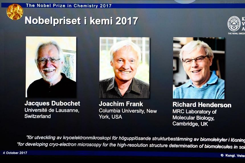 A screen displays portraits of winners of the 2017 Nobel Prize in Chemistry, (from left) Jacques Dubochet from Switzerland, Joachim Frank from the US and Richard Henderson from Britain on Oct 4, 2017.