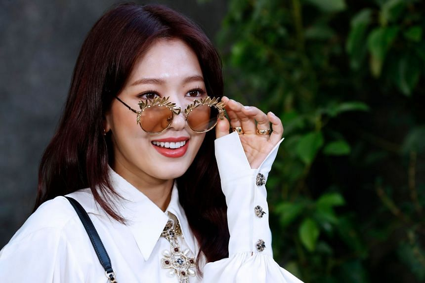 Korean actress Park Shin-Hye poses during a photocall prior to the Chanel show.