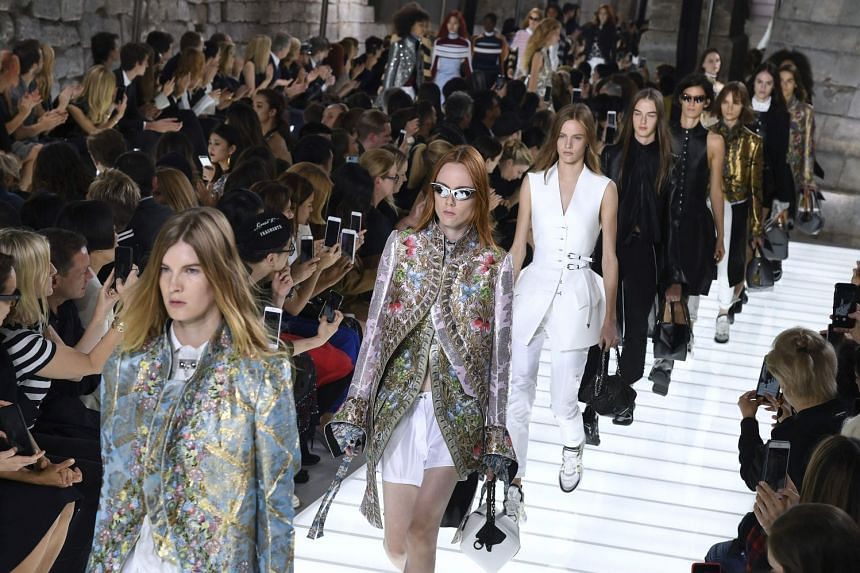 Models present creations for Louis Vuitton during the women's 2018 Spring/Summer ready-to-wear collection.