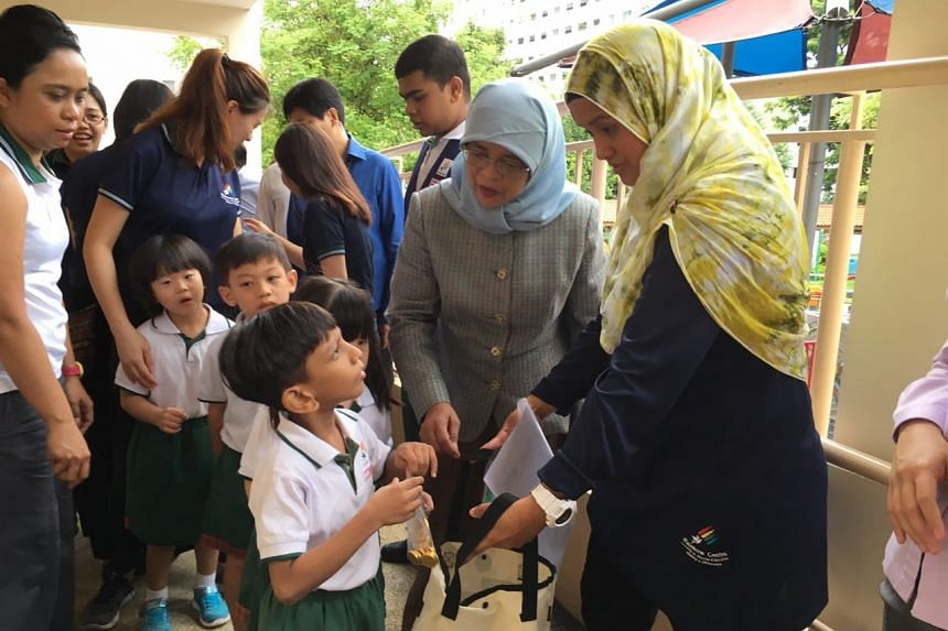 President Halimah Yacob talks to a pupil during her visit to the Rainbow Centre Yishun Park School for children with special needs.