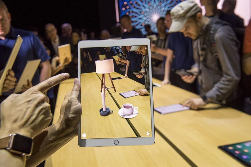 An attendee demonstrates the ARKit, augmented reality tool, on an Apple Inc. iPad Pro during the Apple Worldwide Developers Conference (WWDC) in San Jose, California.