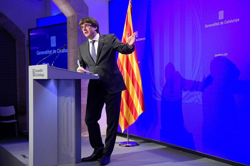 Catalan president Carles Puigdemont gives a press conference in Barcelona.