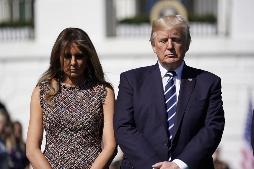 US President Donald Trump stands with first lady Melania Trump as he leads a moment of silence in the wake of the the mass shooting in Las Vegas at the White House in Washington, on Oct 2, 2017.