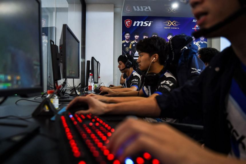 Taiwanese gamers from the eSports team Flash Wolves play during training for the League of Legends World Championship at a boot camp in Shanghai.