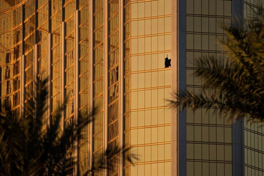 A window is broken on the 32nd floor of the Mandalay Bay Resort and Casino where a gunman opened fire on a concert crowd on Sunday night, on Oct 3, 2017 in Las Vegas, Nevada.