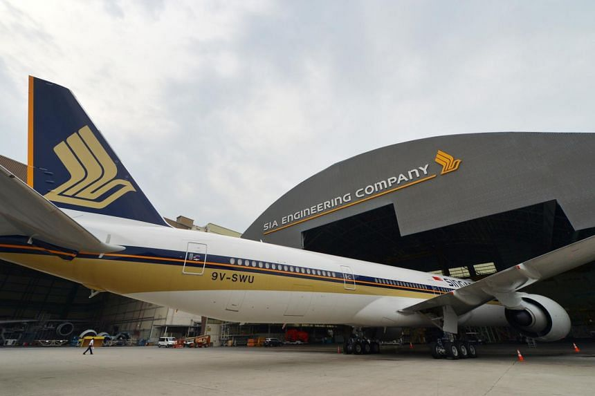 A Singapore Airlines Boeing 777-300 is seen parked in the SIA Engineering Company hangar.