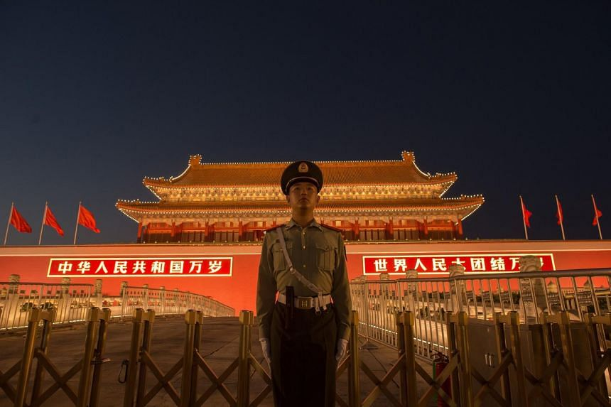 A Chinese paramilitary police officer secures the front gate of the Forbidden City in Beijing on Sept 28, 2017.