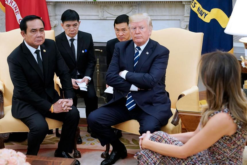 US President Donald Trump and Thailand's Prime Minister Prayut Chan-o-cha take part in a meeting in the Oval Office of the White House on Oct 2, 2017.