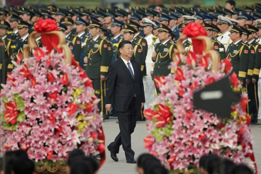 Chinese President Xi Jinping arrives to attend a tribute ceremony in front of the Monument to the People's Heroes at Tiananmen Square in Beijing.