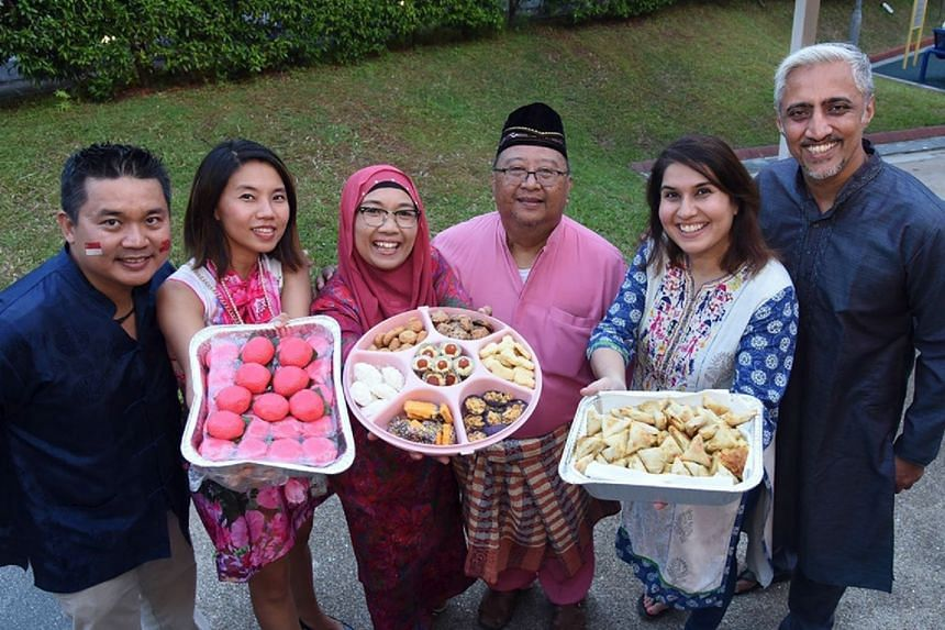 Ulu Pandan residents sharing desserts from different cultures. MPs such as Mr Christopher De Souza and Mr Gan Thiam Poh have noted how food can be a unifying experience across cultures.