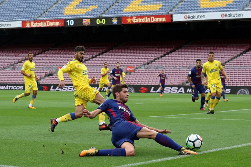 Barcelona and Las Palmas players competing in front of an empty Camp Nou last Sunday due to the club's decision to protest against the heavy-handed approach towards the referendum on Catalan independence.