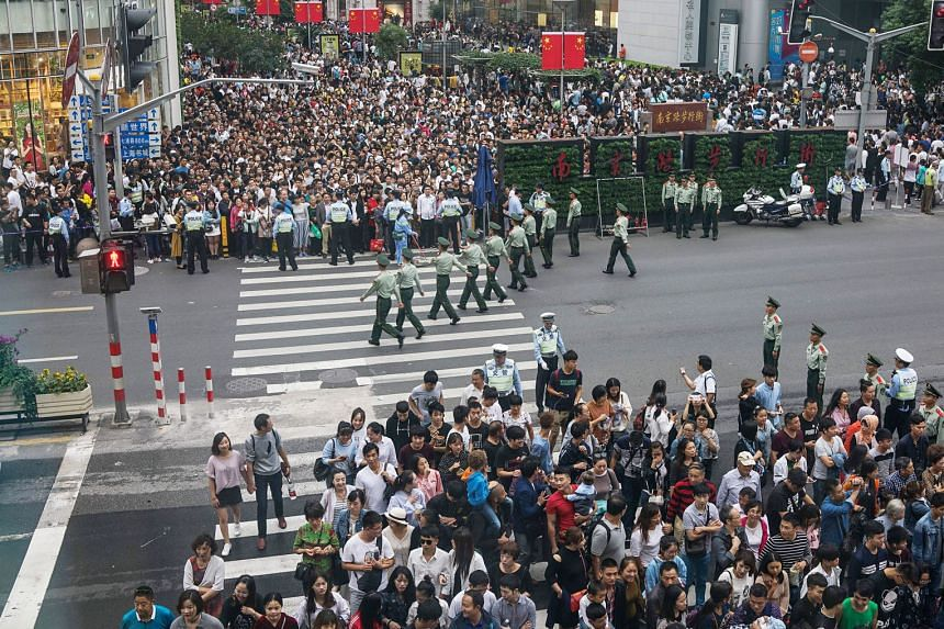 """Police in Shanghai taking steps to control the large crowds yesterday. South Korea did not make the top 20 destinations for over six million users of the leading travel website Ctrip, who were travelling abroad during China's """"Golden Week"""" holiday. T"""