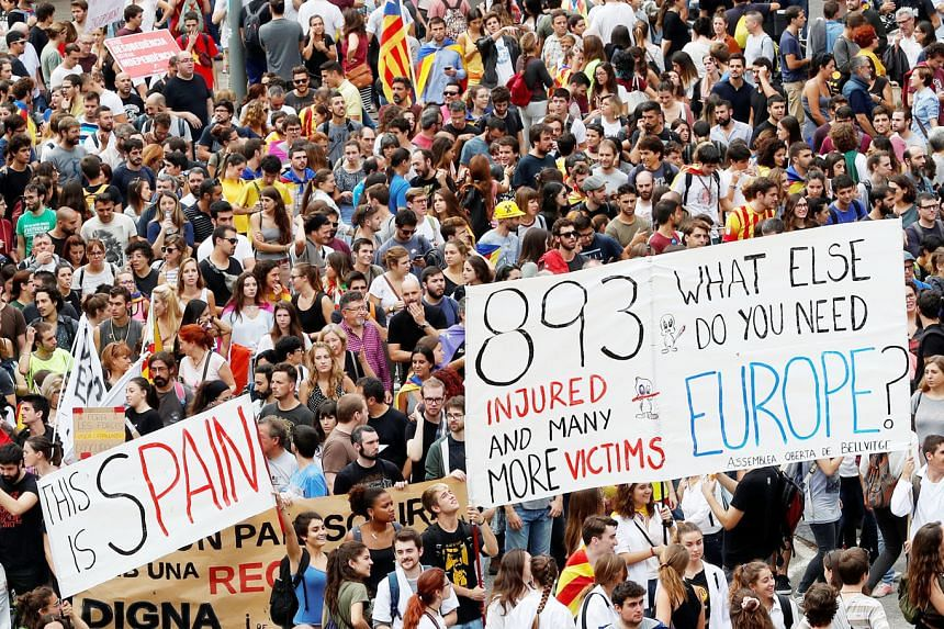 People demonstrating yesterday against police violence during Sunday's Catalonia independence vote took to the roads and highways, blocking traffic. Schools and some businesses also shut in protest. Many were injured on Sunday after riot police tried