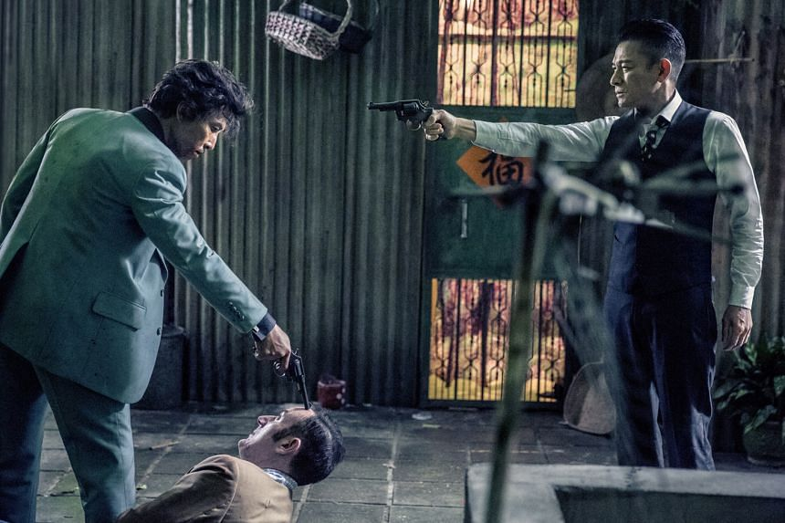 Donnie Yen (far left) as real-life drug lord Ng Sik Ho and Andy Lau as a corrupt police officer in Chasing The Dragon.