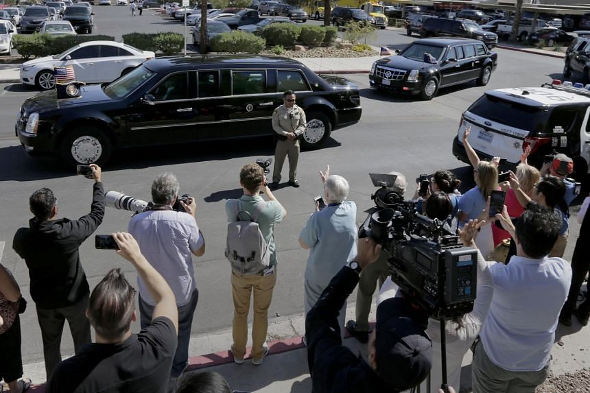 Trump leaves University Medical Centre in his motorcade after meeting hospital personnel and victims of the mass shooting.