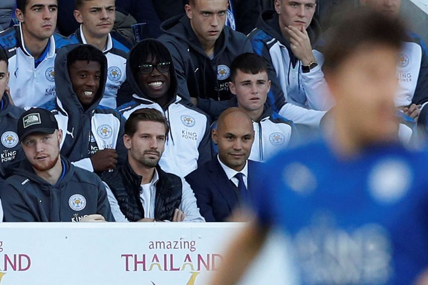 Leicester City's Adrien Silva (front row, centre) sits in the stands during a game.