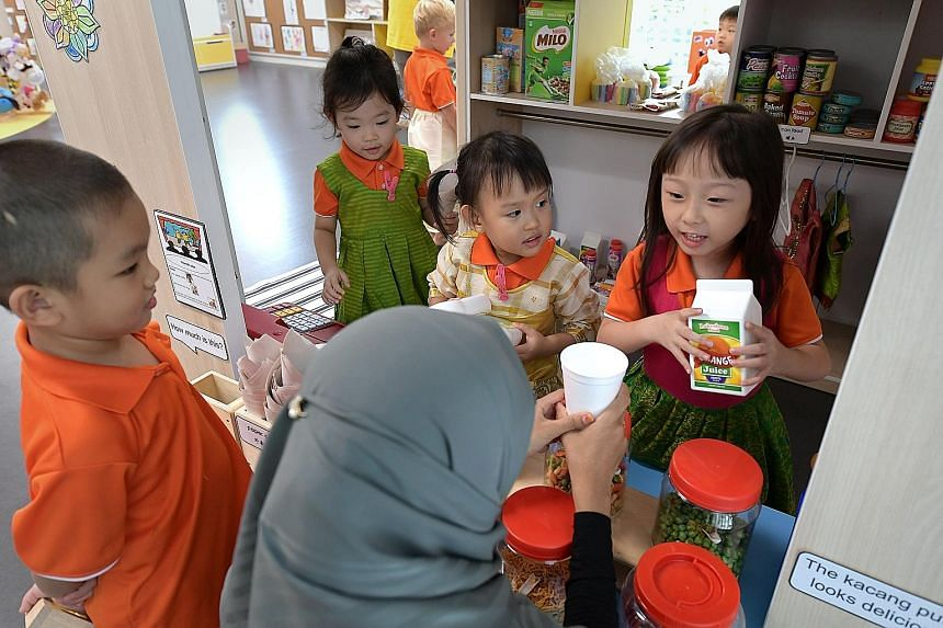 """Children at My First Skool at 10, Jurong West, role-playing in a """"provision shop"""". The centre is meant to be a model in terms of teaching mother tongue languages and cultures in the pre-school sector."""