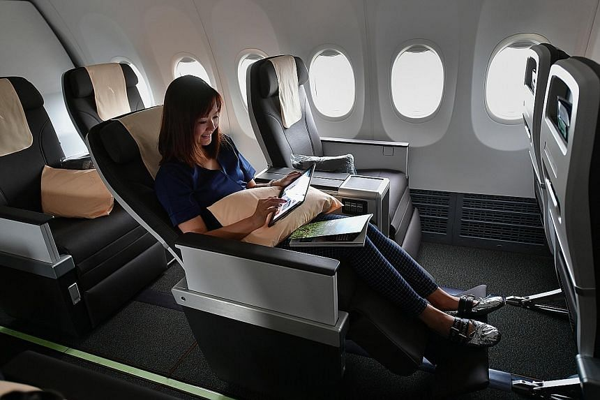 SilkAir staff member Nicole Lew, 38, in the business class section of the new Boeing 737 Max 8 plane.
