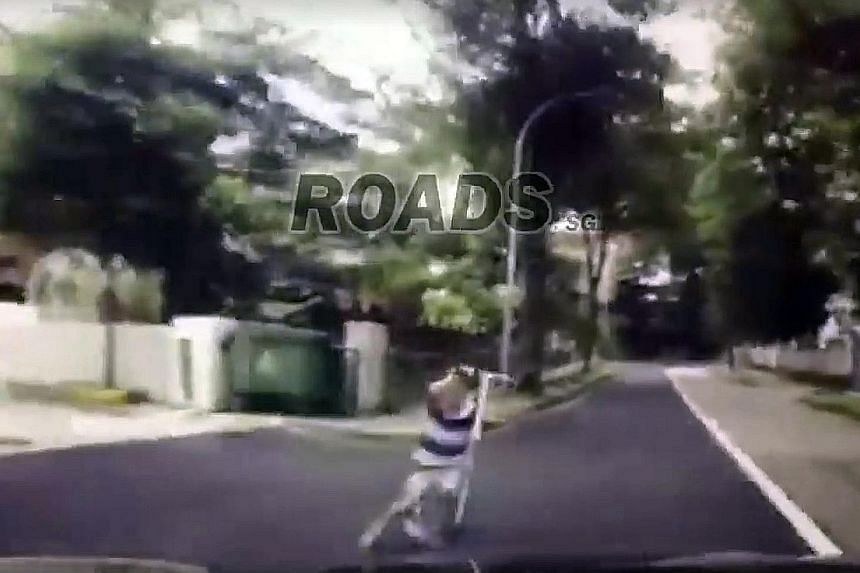 A series of screengrabs from the dashcam footage, posted on Facebook, that shows the boy being hit. The boy is seen crying on the road, while a woman runs towards him. He was taken conscious to National University Hospital.