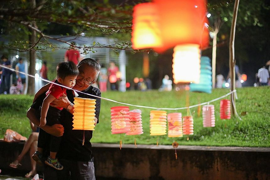 It was the Mid-Autumn Festival, and retiree William Koh, 66, took the opportunity to teach his 20-month-old grandson Barden Koh to count the lanterns hanging from a rope. At Bishan-Ang Mo Kio Park last night, families were out, armed with colourful l