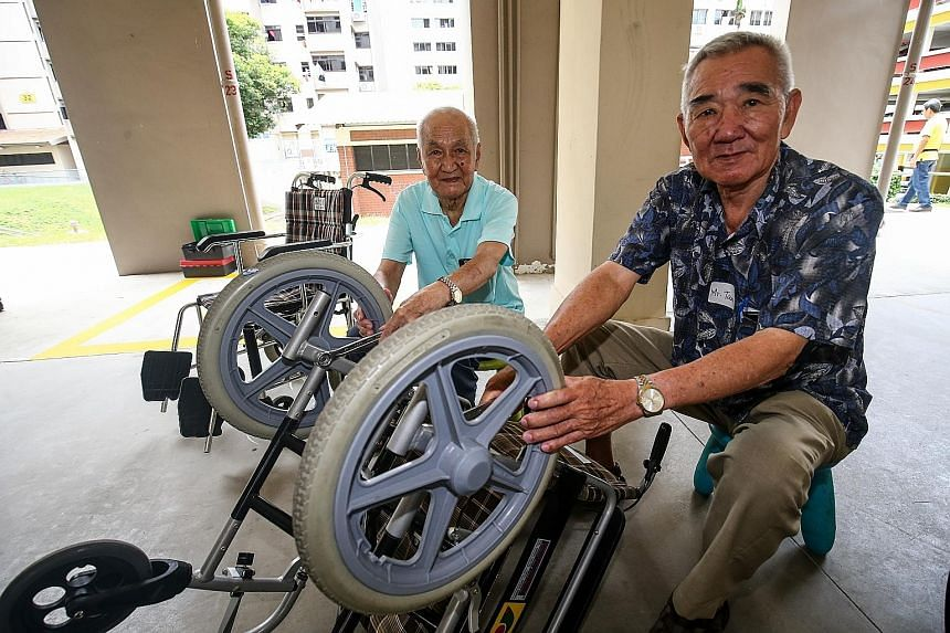 Mr Tan Tan Tong, 84, (far left) and Mr Tan Seng Kin, 73, are among the 30 from the five senior activity centres who will be trained to service wheelchairs for other low-income seniors, as part of a three-year pilot programme.