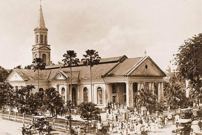 The cathedral in the 1910s. Constructed between 1843 and 1847, it is Singapore's oldest Catholic place of worship. It was gazetted as a national monument in 1973. Doing God's work are (from left) volunteer Alexander Charles Louis; Father Adrian Antho