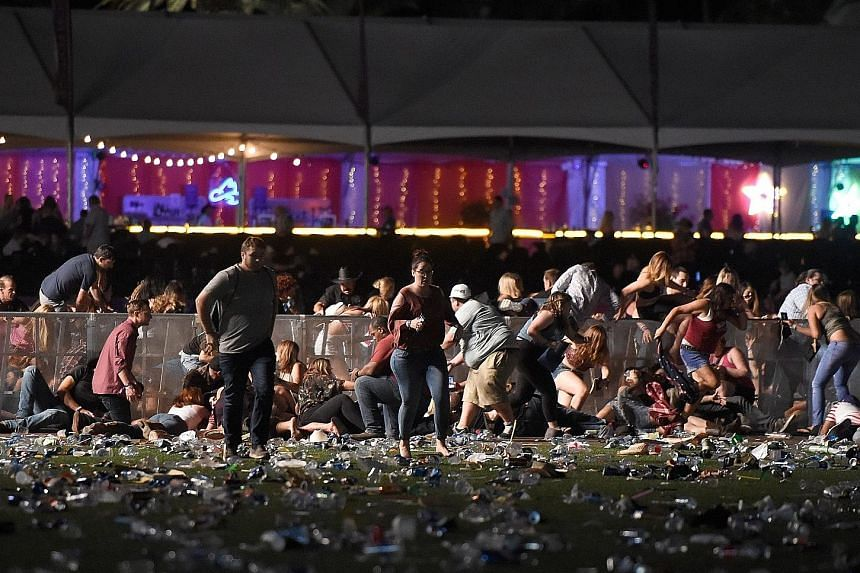 Concertgoers at the Route 91 Harvest country music festival running for safety after a gunman went on a shooting spree from a window at the Mandalay Bay Resort and Casino, about 365m away from the festival site.