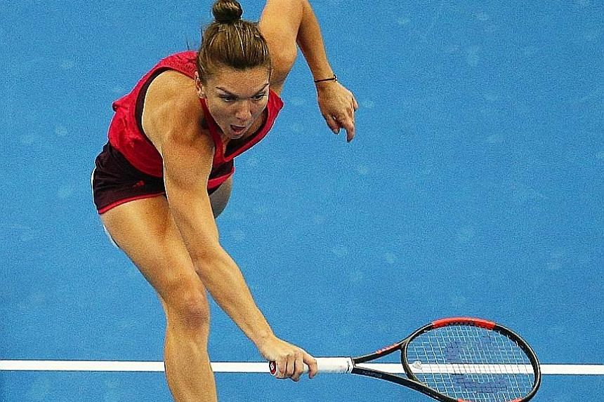 Simona Halep (left) is now the China Open favourite after demolishing Maria Sharapova in the third round in Beijing yesterday. She is delighted to finally taste victory against the former world No. 1, and fans in Singapore can look forward to watchin