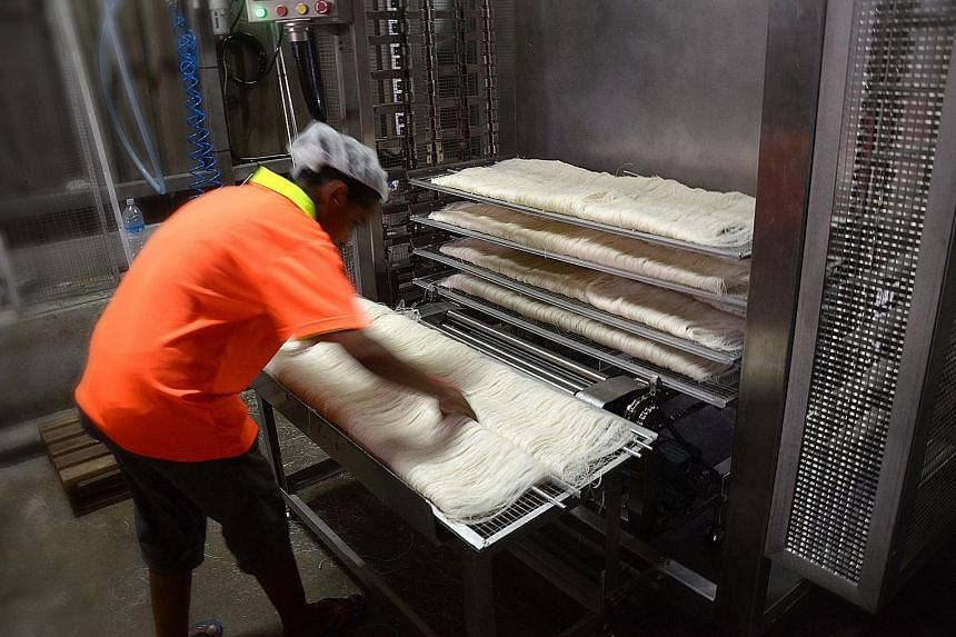 According to People Bee Hoon Factory director Desmond Goh (above), only two workers are needed for the bee hoon folding process with the help of the machine developed by ITE. The manual process originally required 10 workers.