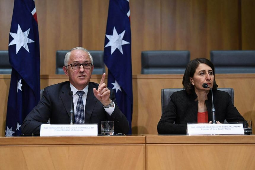 Australian Prime Minister Malcolm Turnbull and New South Wales Premier Gladys Berejiklian at a special meeting on counter-terrorism of the Council of Australian Governments (COAG) at Parliament House in Canberra, on Oct 5, 2017.