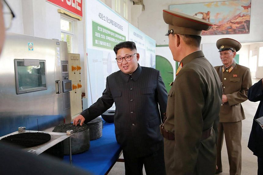 North Korean leader Kim Jong Un gives field guidance during a visit to the Chemical Material Institute of the Academy of Defence Science in this undated photo.
