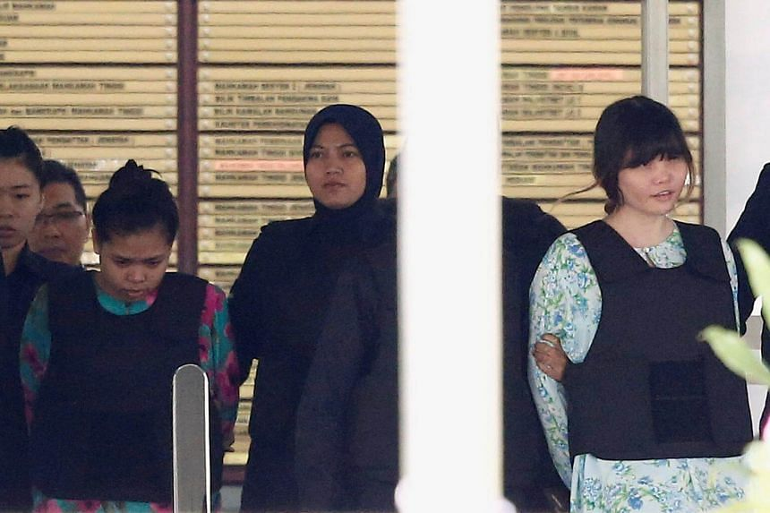 Doan Thi Huong (right) and Siti Aisyah who are on trial for the killing of Kim Jong Nam are escorted as they leave the Shah Alam High Court on the outskirts of Kuala Lumpur, on Oct 3, 2017.