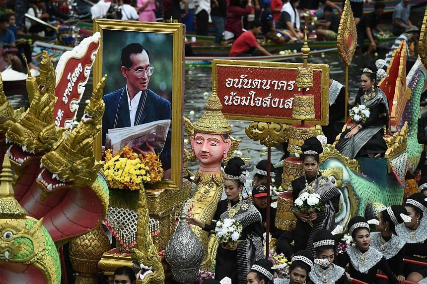 A boat carries a picture of the late Thai king Bhumibol Adulyadej during the Rab Bua (Lotus Receiving) festival.