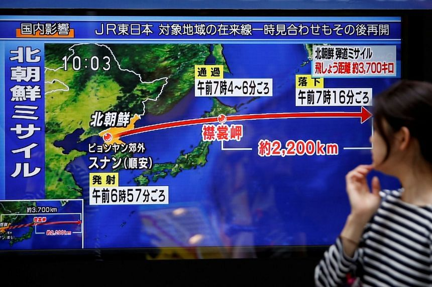 A passer-by looking at a news report on a North Korean missile launch, in Tokyo on Sept 15, 2017. The US has offered to sell 56 air-to-air missiles to Japan, as North Korea poses a greater nuclear threat to the region.