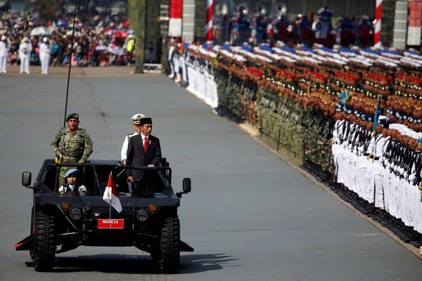 Indonesia's President Joko Widodo inspects the forces during celebrations for the 72nd anniversary of the Indonesia military, in Cilegon, Indonesia  on Oct 5, 2017.
