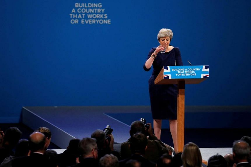 Britain's Prime Minister Theresa May addresses the Conservative Party conference in Manchester on Oct 4, 2017.
