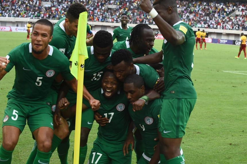 Nigeria's players celebrate after scoring a goal during the 2018 FIFA World Cup qualifying football match on Sept 1, 2017.
