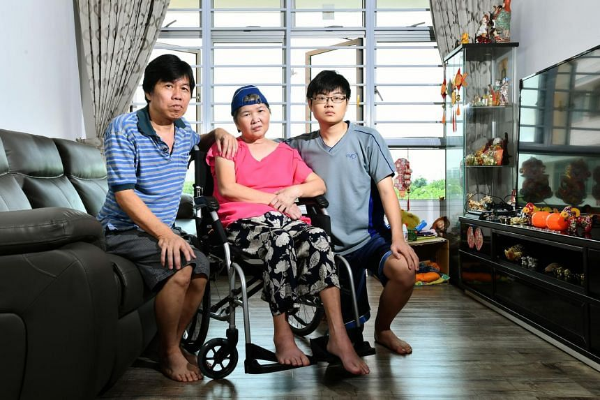 Madam Ang Liu Kiow (centre) with her husband Mr Leong Loon Wah and her son Dominic Leong, at their home on Dec 24, 2016.
