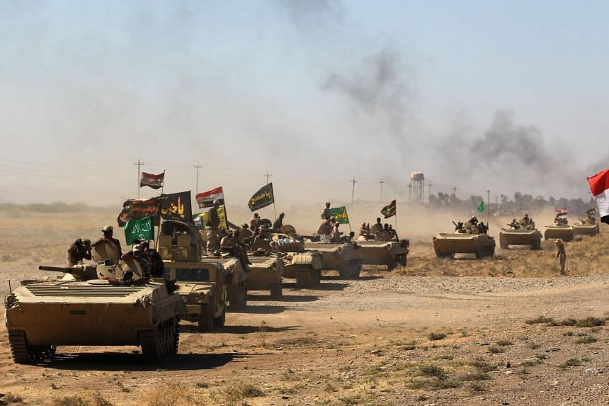 Iraqi forces and fighters from the Hashed al-Shaabi advance towards ISIS' stronghold of Hawija.