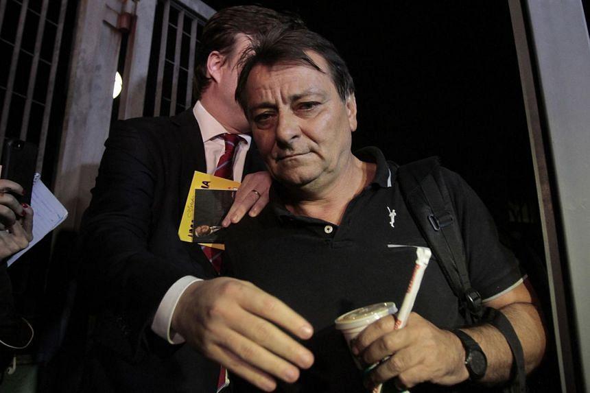 Cesare Battisti leaving the Federal Police headquarters in Sao Paulo, Brazil, on March 13, 2015.