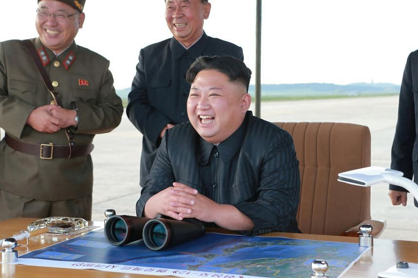 North Korean leader Kim Jong Un guides the launch of a Hwasong-12 missile in this undated photo released by North Korea's Korean Central News Agency, on Sept 16, 2017.